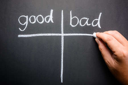 good or bad: Hand writing Good and Bad sorting table with chalk Stock Photo
