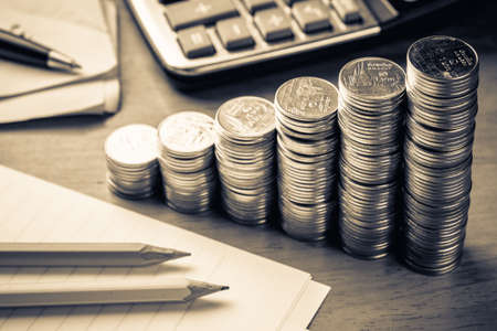 investment banking: Heap coins stair with part of paper note, calculator and bills