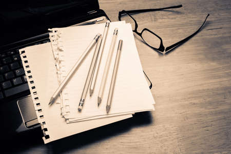 writing desk: Pencils and papers on laptop, communication writing concept Stock Photo