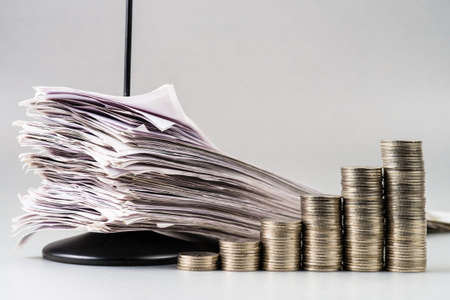 increase sales: Increase sales, heap coins stair with pile of receipts in paper nail