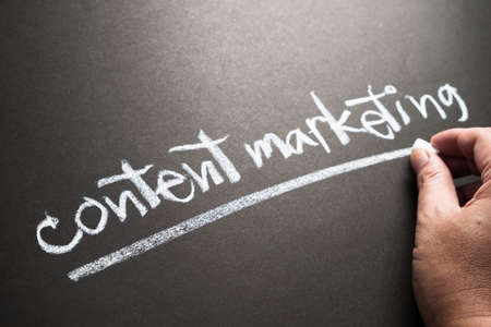 content writing: Hand writing Content Marketing topic with chalk