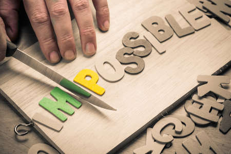 hand cut: Hand cut wood letters on chopping board as Possibility concept