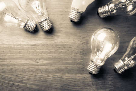 copy space: Light bulbs glowing on wood background
