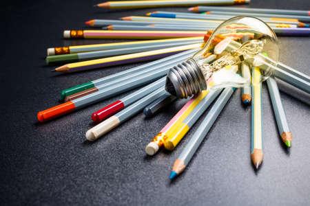 creativity: Light bulb with many pencils