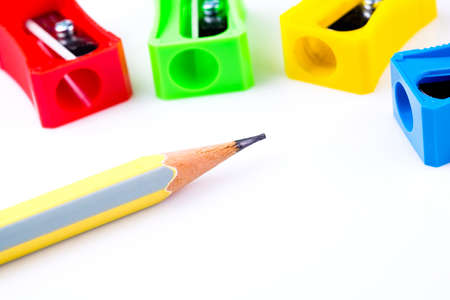 sharpeners: Pencil and colorful sharpeners on white background