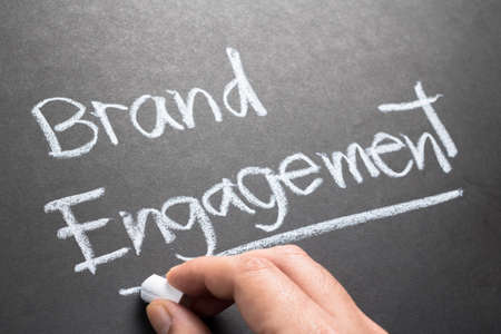 topic: Hand writing Brand Engagement topic on chalkboard