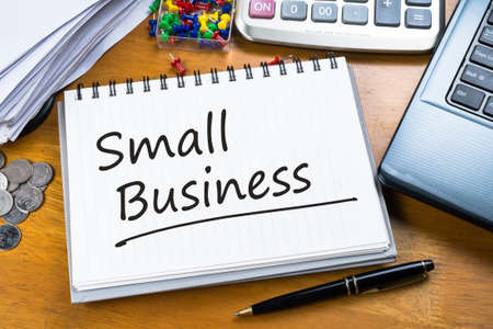 business owner: Handwriting of Small Business on working table Stock Photo