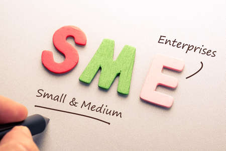 Wood letter of SME with hand writing definition