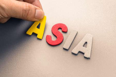 arrange: Hand arrange wood letters as Asia word Stock Photo