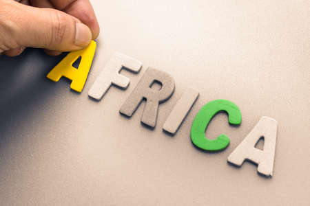 to arrange: Hand arrange wood letters as Africa word Stock Photo