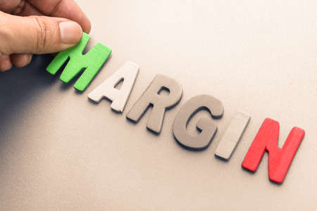 arrange: Hand arrange wood letters as Margin word Stock Photo