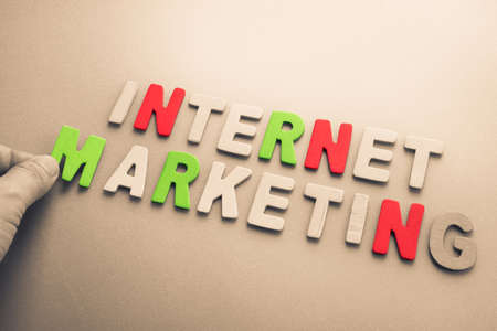 topic: Hand arrange wood letters as Internet Marketing topic