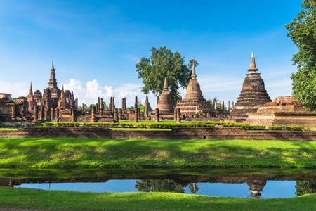 Castle and pagodas in Sukhothai Historical Park in Thailand, world heritage