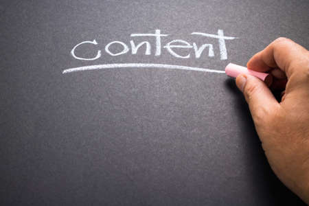 topic: Hand writing Content topic on chalkboard Stock Photo