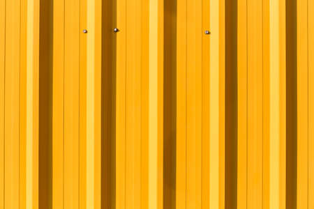corrugated metal: Yellow corrugated metal sheet, abstract background Stock Photo