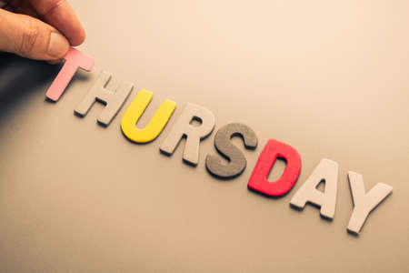 the thursday: Hand arrange wood letters as Thursday word Stock Photo