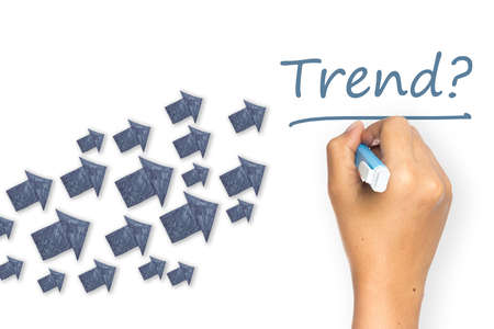 topic: Hand writing Trend topic with many paper arrows as symbol