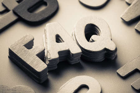 frequently asked questions: Stack wood letters of FAQ abbreviation ( frequently asked questions ) Stock Photo