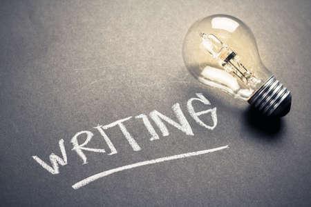 glowing light bulb: Handwriting of Writing word on chalkboard with glowing light bulb