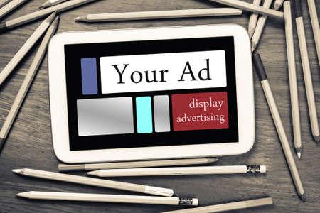 display advertising: Digital display advertising panel on mobile tablet