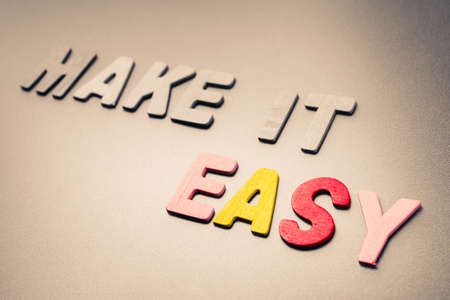 arranged: Make it Easy text arranged by wood letters