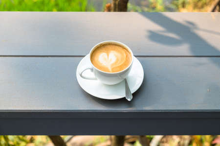 wood bench: Cup of cappuccino outdoor on wood bench