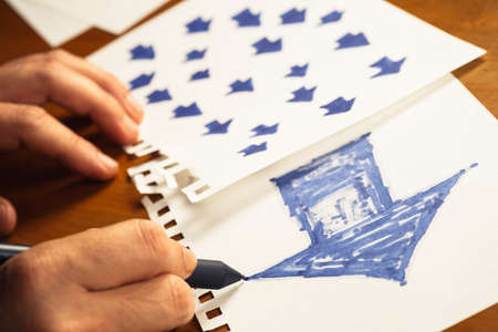 follower: Hand drawing big arrow on paper as trend leader with many small arrows in another paper as follower Stock Photo