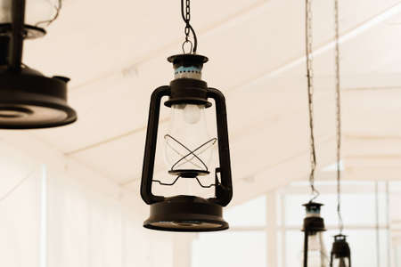 classic light bulb: Old lantern apply as decorated electric lamp hanged on ceiling