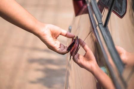open car door: Closeup hand going to open car door