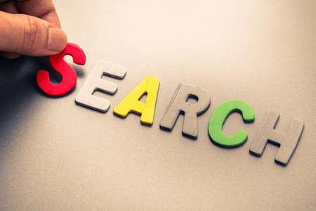 arrange: Hand arrange wood letters as Search word