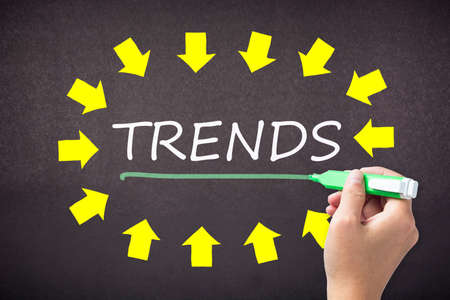topic: Hand underline Trends topic at the center of many arrows Stock Photo
