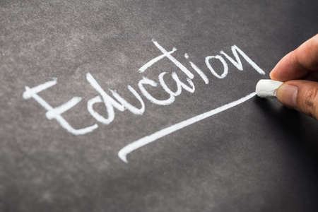 topic: Hand writing Education topic on chalkboard