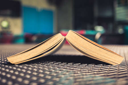 pocket book: Opened pocket book place upside down on the metal wire surface table Stock Photo