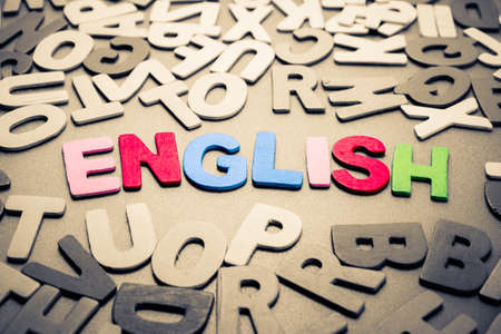 english letters: English word in scattered wood letters Stock Photo