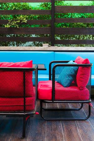 metal mesh: Metal mesh chair and red fabric cushion