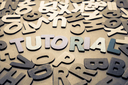 jumble: Tutorial word in scattered wood letters
