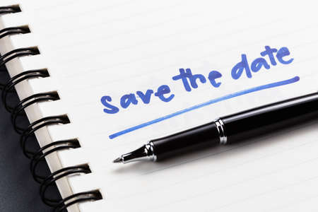 Save The Date text as memo on notebook Imagens