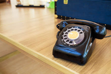 old desk: Old analog telephone on the desk Stock Photo