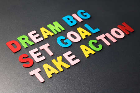 set goal: Dream Big - Set Goal - Take Action in colorful wood letters