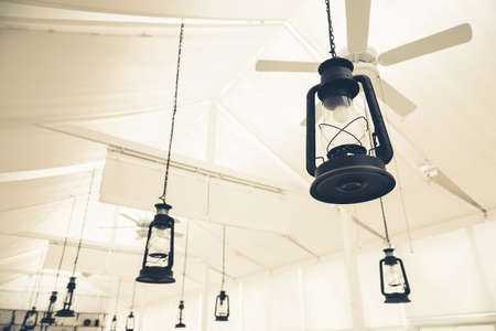 hanged: Old lantern apply as decorated electric lamp hanged on ceiling
