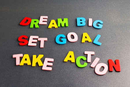 take action: Dream Big - Set Goal - Take Action in colorful wood letters