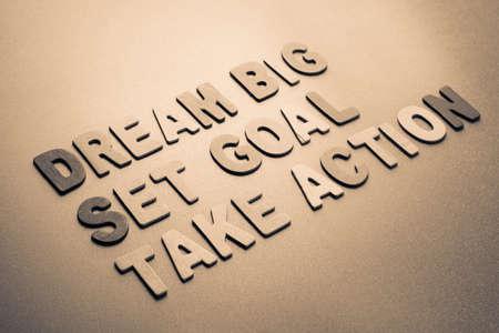 set goal: Wood letters arranged as Dream Big, Set Goal, Take Action
