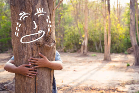 soothe: Save Forest concept, woman give a hug to soothe the crying tree in the forest Stock Photo