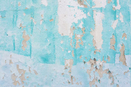Old cement wall with green chipped paint