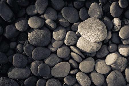 black pebbles: Pebbles on the ground, black and white Stock Photo