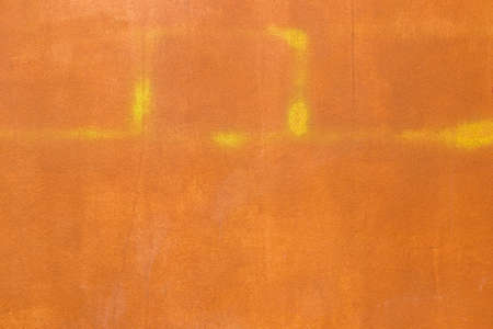 sprayed: Orange cement wall texture with some yellow sprayed Stock Photo