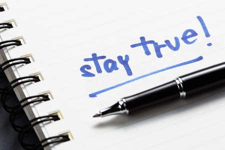true: Stay True text as memo on notebook