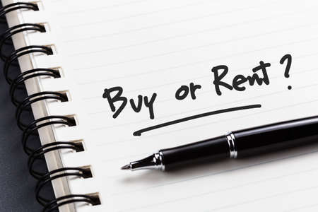 buying questions: Buy or Rent question as memo on notebook Stock Photo