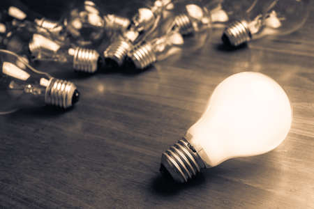 in differentiation: White light bulb glowing separate from the others