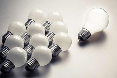 follower: Big light bulb as leader with many small bulbs as follower Stock Photo